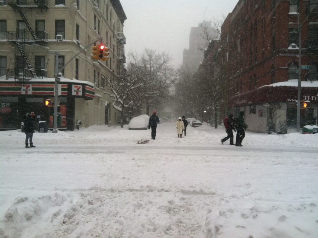 Sledders heading to the park, during the storm