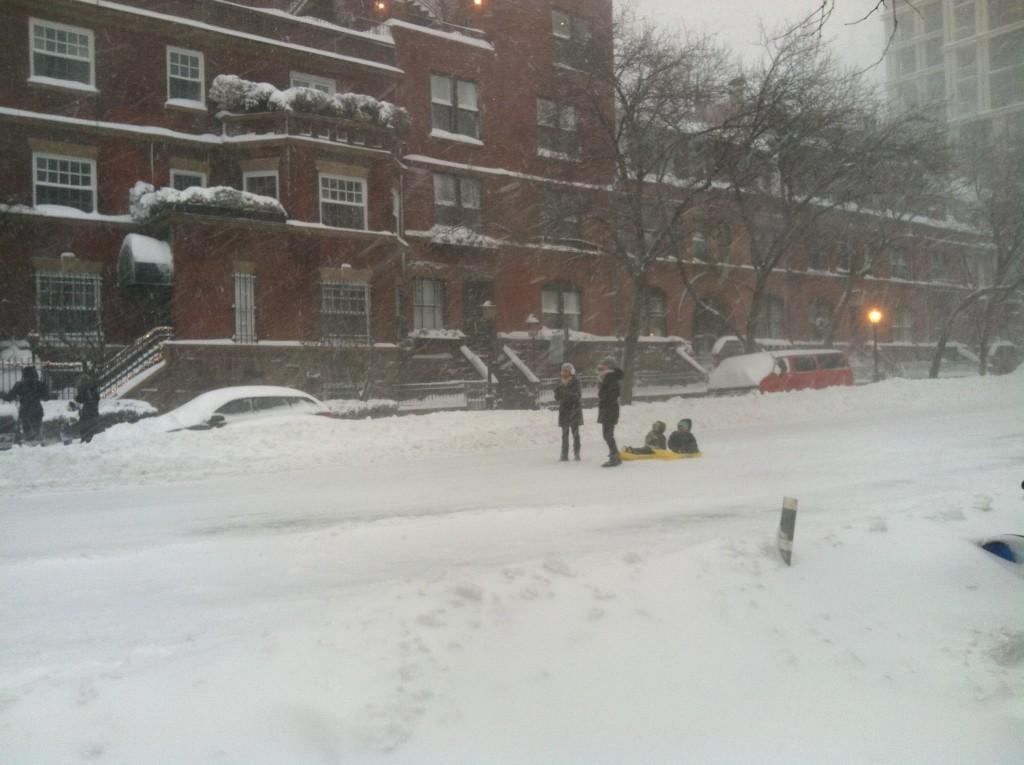 More sledders in the street