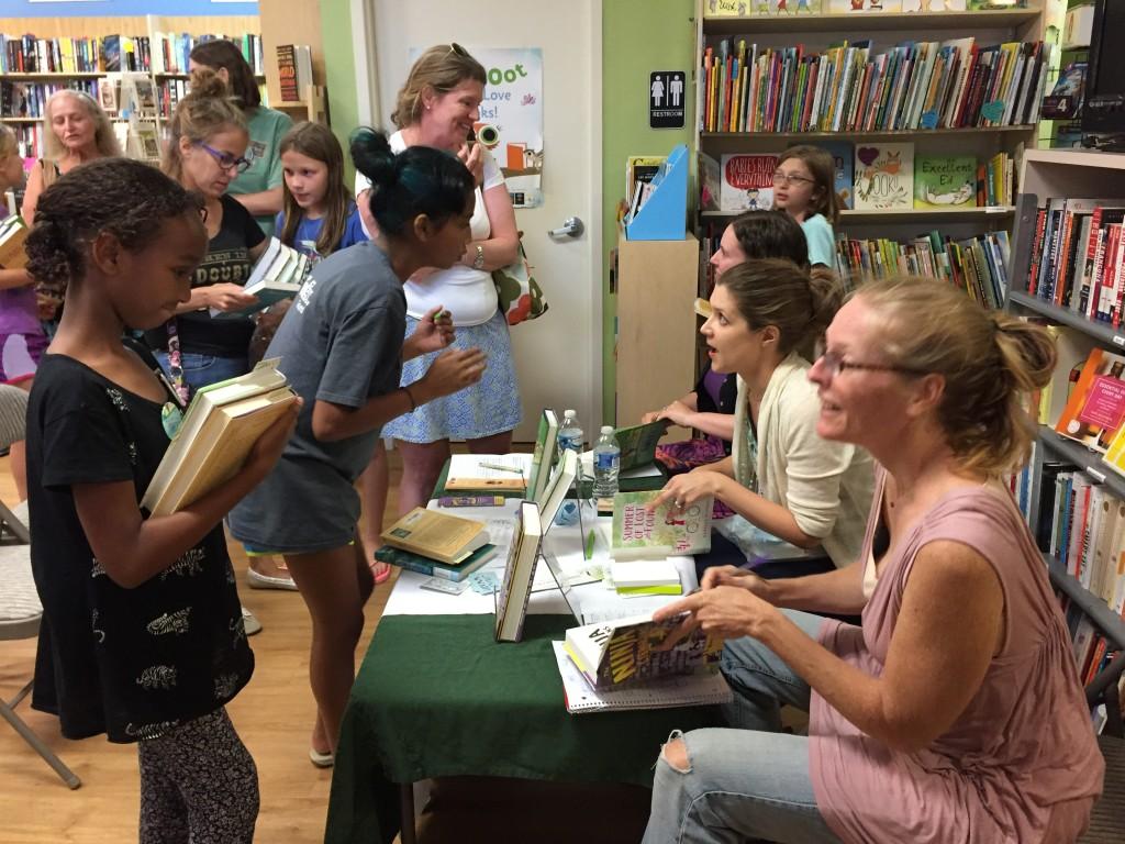 Tara Rebecca and Jen Signing books July